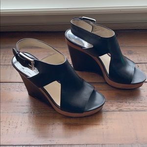 Michael Kors black leather wedge. Size 7.